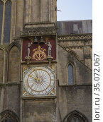 The outer face of the 14th century Wells Cathedral clock in the north... Стоковое фото, фотограф Craig Joiner / age Fotostock / Фотобанк Лори