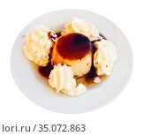 Tasty dessert cream flan served with butter cream at plate. Стоковое фото, фотограф Яков Филимонов / Фотобанк Лори