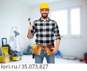 happy male builder in helmet with hammer. Стоковое фото, фотограф Syda Productions / Фотобанк Лори