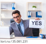 Businessman in positive yes answer in the office. Стоковое фото, фотограф Elnur / Фотобанк Лори