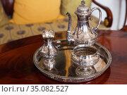 Vintage silver dishware set with jug. Стоковое фото, фотограф EugeneSergeev / Фотобанк Лори