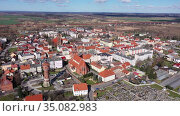 View from drone of Zmigrod townscape on sunny spring day, Lower Silesia Province, Poland. Стоковое видео, видеограф Яков Филимонов / Фотобанк Лори