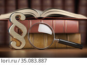 Paragraph sign with loupe and books. Searching, justice and law concept. Стоковое фото, фотограф Maksym Yemelyanov / Фотобанк Лори