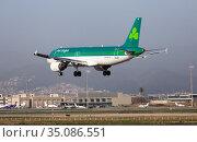 Airline Aer Lingus plane comes in for a landing in an aeroport El Prat city of Barcelona. Редакционное фото, фотограф Яков Филимонов / Фотобанк Лори