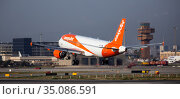 Airplane EasyJet airline lands on the runway in an aeroport El Prat city of Barcelona. Board number G-EZFZ. Редакционное фото, фотограф Яков Филимонов / Фотобанк Лори