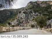 Rock-cut tombs in Myra, Turkey. Стоковое фото, фотограф Юлия Белоусова / Фотобанк Лори