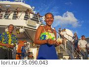 Entertainment group singing in the Paul Gauguin cruise ship. France... Редакционное фото, фотограф Sergi Reboredo / age Fotostock / Фотобанк Лори