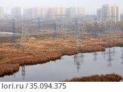 Electric towers with residential buildings. Стоковое фото, фотограф Азат Хайрутдинов / Фотобанк Лори