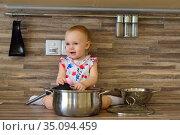 Little girl in a pot cooking dinner. Стоковое фото, фотограф Арестов Андрей Павлович / Фотобанк Лори