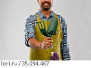 indian gardener or farmer with garden tools. Стоковое фото, фотограф Syda Productions / Фотобанк Лори