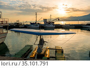 Seaport with moored yachts and boats at sunset with mountains in the background (2018 год). Стоковое фото, фотограф Константин Лабунский / Фотобанк Лори