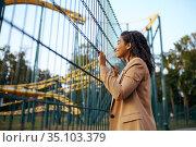 Happy woman at roller coaster in amusement park. Стоковое фото, фотограф Tryapitsyn Sergiy / Фотобанк Лори