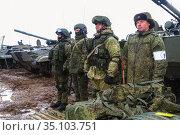 Volgograd, RUSSIA - March 28, 2018: The tank crew was built in the ranks before the combat exercises. Редакционное фото, фотограф Владимир Арсентьев / Фотобанк Лори