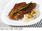 Beef steak with mushrooms sauce branch of rosemary at white plate. Стоковое фото, фотограф Яков Филимонов / Фотобанк Лори