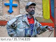 Devotee at the Abuna Garima monastery Tigray. Abba Garima Monastery... (2020 год). Редакционное фото, фотограф Sergi Reboredo / age Fotostock / Фотобанк Лори
