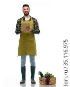 happy gardener with clipboard with garden tools. Стоковое фото, фотограф Syda Productions / Фотобанк Лори