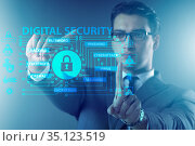 Digital security concept with businessman pressing button. Стоковое фото, фотограф Elnur / Фотобанк Лори