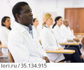 African american doctor attending lectures at refresher course. Стоковое фото, фотограф Яков Филимонов / Фотобанк Лори
