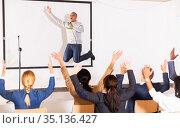 Male coach giving speech at conference hall. Стоковое фото, фотограф Яков Филимонов / Фотобанк Лори