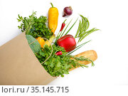 Fresh vegetables and fruits in paper bag, top view. Стоковое фото, фотограф Tryapitsyn Sergiy / Фотобанк Лори