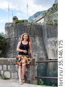 Attractive woman standing close to the San Giovanni Fortress in old town of the Kotor city, Montenegro (2016 год). Стоковое фото, фотограф Кекяляйнен Андрей / Фотобанк Лори