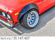 Tuned Lada vehicle with automotive wheel on metal disc (2019 год). Редакционное фото, фотограф FotograFF / Фотобанк Лори