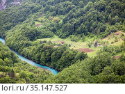 Rural landscape with country house of local farm in the green mountain forests. The Tara river, Montenegro (2016 год). Стоковое фото, фотограф Кекяляйнен Андрей / Фотобанк Лори