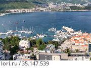 Adriatic sea with port of Budva city full of small yachts. Aerial view. The Budva Riviera. Marina berths during the summerю Budva, Montenegro (2016 год). Редакционное фото, фотограф Кекяляйнен Андрей / Фотобанк Лори