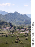 Aerial view at small tourists village the Virpazar. It is on the Crmnica river, close to the Skadar lake and located in the municipality of Bar. Virpazar, Montenegro (2016 год). Редакционное фото, фотограф Кекяляйнен Андрей / Фотобанк Лори