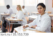 Confident asian female doctor listening refresher course. Стоковое фото, фотограф Яков Филимонов / Фотобанк Лори