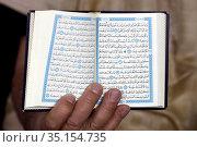 Muslim reading the Quran. France. Стоковое фото, фотограф Fred de Noyelle / Godong / age Fotostock / Фотобанк Лори