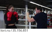 Gym training - young pretty woman training her boxing on the ring with trainer and having fun. Стоковое видео, видеограф Константин Шишкин / Фотобанк Лори