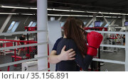Gym training - young pretty woman training her boxing technics on the ring with trainer. Стоковое видео, видеограф Константин Шишкин / Фотобанк Лори