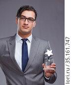The businessman holding star award in business concept. Стоковое фото, фотограф Elnur / Фотобанк Лори