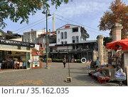 Ortakoy Square in the fall. Besiktas district, city of Istanbul in Turkey. Редакционное фото, фотограф Bala-Kate / Фотобанк Лори