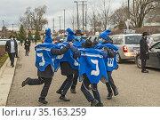 Southfield, Michigan - Boys dance as sars line up for a Car Top Menorah... Редакционное фото, фотограф Jim West / age Fotostock / Фотобанк Лори