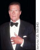 Roger Moore 1991.Photo By John Barrett/PHOTOlink.. (2005 год). Редакционное фото, фотограф Adam Scull / age Fotostock / Фотобанк Лори