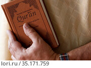 Muslim reading and english version of the Quran. France. Стоковое фото, фотограф Pascal Deloche / Godong / age Fotostock / Фотобанк Лори