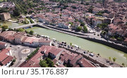 Panoramic aerial view of Condom city on Baise river on sunny summer day, Gers, France. Стоковое видео, видеограф Яков Филимонов / Фотобанк Лори