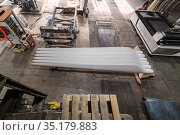 Wind turbine blades in the factory floor. View from above. Photo taken at an industrial plant in Russia. Стоковое фото, фотограф Вадим Орлов / Фотобанк Лори