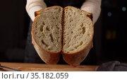 female baker showing homemade bread at bakery. Стоковое видео, видеограф Syda Productions / Фотобанк Лори