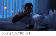 indian man awaking at night and drinking water. Стоковое видео, видеограф Syda Productions / Фотобанк Лори