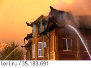 Russia Samara January 2020: EMERCOM employees extinguish a fire at night in winter. Стоковое фото, фотограф Акиньшин Владимир / Фотобанк Лори