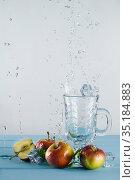 Mint, apples, ice cubes and Splashing water. Стоковое фото, фотограф Александр Иванов / Фотобанк Лори
