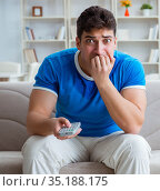 Man sweating excessively smelling bad at home. Стоковое фото, фотограф Elnur / Фотобанк Лори