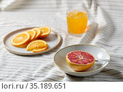 grapefruit, sliced orange and glass of juice. Стоковое фото, фотограф Syda Productions / Фотобанк Лори