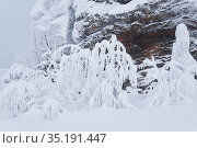 Frozen rock and trees with icy branches on a mountain pass after blizzard. Стоковое фото, фотограф Евгений Харитонов / Фотобанк Лори