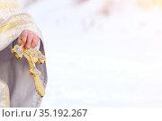 Priest holds golden cross in his hands. Copy space. Стоковое фото, фотограф Иван Карпов / Фотобанк Лори