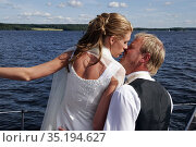 The bride and groom kiss each other. Model release. Стоковое фото, фотограф Andre Maslennikov / age Fotostock / Фотобанк Лори