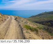 Mountain dirt road to the sea coast. Стоковое фото, фотограф Юрий Бизгаймер / Фотобанк Лори